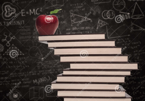 Apple on top of pile of books